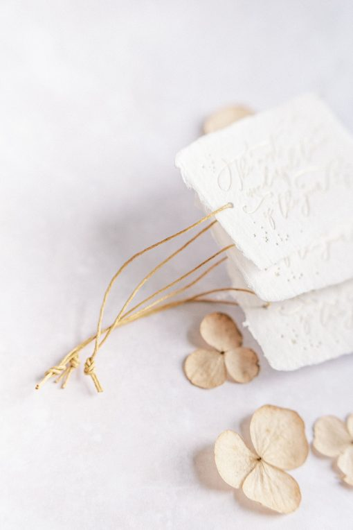 Handmade paper gift tags with gold paper twine