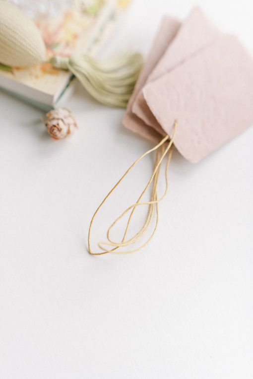 Pink tag with paper twine