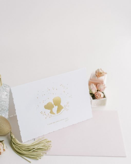 Gold foil card with the words I told the stars about you'.