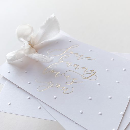 Smooth white card with silk ribbon.