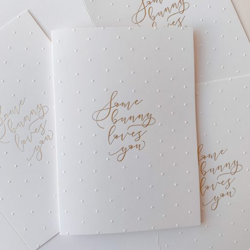 White bunny loves card with gold foil and blind emboss polka dots.