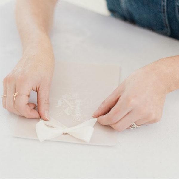 Hand tying ribbon